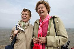 Two elderly women by the sea,