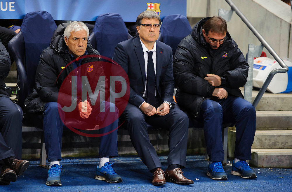 Barcelona Manager Gerardo Martino (ARG) sits in the dugout with his assistants - Photo mandatory by-line: Rogan Thomson/JMP - Tel: 07966 386802 - 18/02/2014 - SPORT - FOOTBALL - Etihad Stadium, Manchester - Manchester City v Barcelona - UEFA Champions League, Round of 16, First leg.