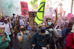 Climate activists from Extinction Rebellion let off coloured smoke grenades during a march to a Back The Bill rally in Parliament Square on 1st September 2020 in London, United Kingdom. Extinction Rebellion activists are attending a series of September Rebellion protests around the UK to call on politicians to back the Climate and Ecological Emergency Bill (CEE Bill) which requires, among other measures, a serious plan to deal with the UK's share of emissions and to halt critical rises in global temperatures and for ordinary people to be involved in future environmental planning by means of a Citizens' Assembly.