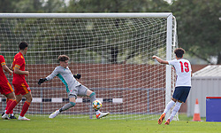 NEWPORT, WALES - Friday, September 3, 2021: England's Kaide Gordon (R) sees his shot saved by Wales' goalkeeper Ronnie Hollingshead during an International Friendly Challenge match between Wales Under-18's and England Under-18's at Spytty Park. (Pic by David Rawcliffe/Propaganda)