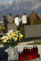 People standing at the cemetery.  (Photo by: Vid Ponikvar / Sportal Images).