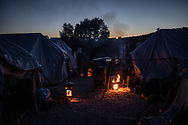 Families preparing dinner on wood fires. About 20000 are living in a makeshift camp nearby the city of Moria on the island of Lesbos in miserable conditions, most of the without water, electricity nor sanitary facilities.  Federico Scoppa
