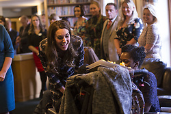 The Duchess of Cambridge speak with familes receiving support, staff and trustees during a visit to Francis House hospice in Manchester.