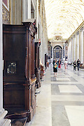 confessionals in a grand cathedral in Italy Rome