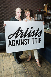 © Licensed to London News Pictures. 02/07/2015. London, UK. VIVIENNE WESTWOOD and CAROLINE LUCAS at an artists against Transatlantic Trade and Partnership (TTIP) photocall at the New Vic Theatre in London. The TTIP is a free trade and investment treaty currently being negotiated between the European Union and the USA. Photo credit : Vickie Flores/LNP
