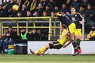 Oxford United's Curtis Nelson (5) heads clear under pressure from Burton Albion forward Liam Boyce (27) during the EFL Sky Bet League 1 match between Burton Albion and Oxford United at the Pirelli Stadium, Burton upon Trent, England on 2 February 2019.