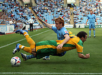 Photo: Rich Eaton.<br /> <br /> Coventry City v Norwich City. Coca Cola Championship. 09/09/2006. Lee Croft of Norwich is floored by Coventrys KevinThornton