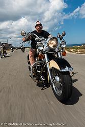 Ray-Ray riding Jay Allen's Shovelhead down A1A during Daytona Bike Week. FL. USA. Sunday March 18, 2018. Photography ©2018 Michael Lichter.