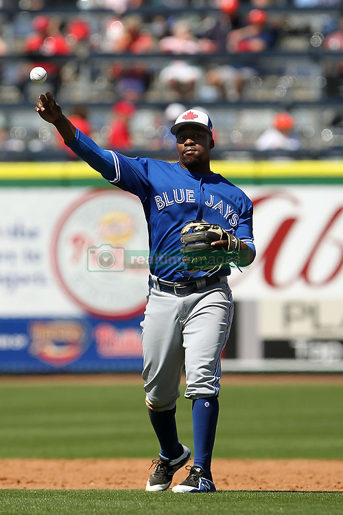 March 16, 2018 - Clearwater, FL, U.S. - CLEARWATER, FL - MARCH 16: Gift Ngoepe (61) of the Blue Jays throws the ball over to first base during the spring training game between the Toronto Blue Jays and the Philadelphia Phillies on March 16, 2018, at Spectrum Field in Clearwater, FL. (Photo by Cliff Welch/Icon Sportswire) (Credit Image: © Cliff Welch/Icon SMI via ZUMA Press)