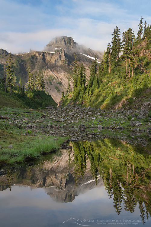 Table Mountain reflected in Bagley Lake. Heather Meadows Recreation Area, Mount Baker Snoqulane National Forest. North Cascades Washington