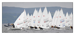 The penultimate days racing in the World Laser Radial Youth Championships, Largs, Scotland. ..Elliot Hanson GBR 195302 tacks onto port to cross the fleet at the start of the first gold fleet race...317 Youth Sailors from 42 different nations compete in the World and European Laser Radial Youth Champiponship from the 17-25 July 2010...The Laser Radial World Championships take place every year. This is the first time they have been held in Scotland and are part of the initiaitve to bring key world class events to Britain in the lead up to the 2012 Olympic Games. ..The Laser is the world's most popular singlehanded sailing dinghy and is sailed and raced worldwide. ..Further media information from .laserworlds@gmail.com.event press officer mobile +44 7866 571932 and +44 1475 675129 .