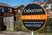 Osbournes For Sale sign outisde a property, Faornborough, Hampshire, UK.