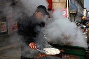 A man steams dumplings at a market in Zhujiao Township, Chuzhou, Anhui Province, China on 02 March, 2011.  Chuzhou is the city where Dongdaxu Village is located, the ancestral home of current Chinese vice premier Li Keqiang, slated to be the next premier and the man in charge of China's economic transformation