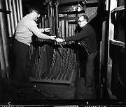 Pipe Organ Dismantling at Aungier Street.  (K86).1977..01.02.1977..02.01.1977..1st February 1977..A pipe organ built around 100 years ago for St Peter's Church (Church of Ireland),at Whitefriar / Aungier Street was being dismantled by Mr Gerry Smith and Mr Sam Wright of Dublin Organ Works. The organ was being dismantled for transfer to St Michael's Church,(Roman Catholic),in Blackrock,Co Cork..Image shows the dismanling of the wooden pipes by Mr Gerry Smith (right) and Mr Sam Wright.