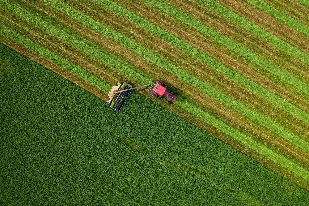 Drone photo of a farmer harvest.