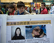 A man reacts as he looks at an exhibition about the persecution of people who Practice Fa Lun Gong in the Chinese mainland in Hong Kong.