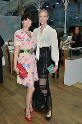 Left to right, JASMINE GUINNESS and JADE PARFITT at The Women for Women International & De Beers Summer Evening held at The Royal Opera House, Covent Garden, London on 23rd June 2014.