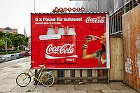 View of a German Coca-Cola billboard, Vienna, Austria.