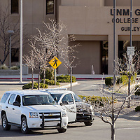 032415       Cable Hoover<br /> <br /> Law enforcement officers occupy the parking lot in front of Gurley Hall at UNM-Gallup Tuesday. Police conducted a room-by-room search of the school after a bomb threat was received.