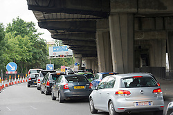 © London News Pictures. 07/07/2012. Traffic queueing underneath the M4 motorway flyover Westbound near junction 1 in London on July 7, 2012. The M4 has been closed between junctions 1 and 3 until Thursday at the earliest after a crack was found in a 'sensitive area' of an elevated section of the motorway. The M4, part of the Olympic Route Network, will be vital for transporting visitors into the city from Heathrow Airport. Photo credit: Ben Cawthra/LNP.