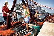 Zadar, Croatia, Jun 16, 2010, Fishermen coming from sea checking their fishingmaterials.