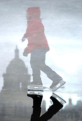 A young ice skater on George Square's festive Ice rink.