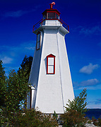 Big Tub Lighthouse, dating from the 1880s, 43-foot-tall hexagonal wooden tower marking the entrance into Big Tub Harbour, Georgian Bay of Lake Huron, Tobermory, Ontario, Canada.