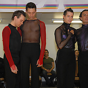 Same-sex ballroom dancers Jean-Francois Fortin, from left, of Montreal, Canada.with Willem Alexander, of, Jersey City and Jacob Jason with Luis Grijalva, both of New York City, react to the announcement of results  in the men's latin A category competition at the 5 Boro Dance Challenge on May 5, 2007...Grijalva and Jason won and Fortin and Alexander came in second.  ..The locally produced 5 Boro Dance Challenge, New York City's first major same-sex dance competition, was held at the Park Central Hotel in Manhattan from May 4-6, 2007. .
