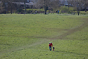As the UK government considers further restrictions of movement in public places during the Coronavirus pandemic, south Londoners mindful of the need for social distancing, stay away from others in Brockwell Park in Herne Hill, on 23rd March 2020, in London, England.