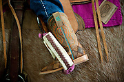 PRICE CHAMBERS / NEWS&GUIDE<br /> 5-year-old Dally Wilson's little cowgirl boots sit high on her horse as she awaits her turn in the arena Saturday morning.