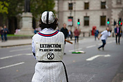 Climate change protester play a game of cricket in the middle of the road around Parliament Square on 7th October, 2019 in London, Untited Kingdom. Extinction Rebellion plan to occupy 12 sites situated around key Government locations around Westminster for two weeks to protest against climate change. (photo by Claire Doherty/In Pictures via Getty Images)
