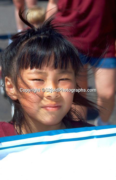 Thoughtful girl age 6 at Asian American Festival.  St Paul  Minnesota USA