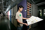graduate student Fay-Wei Li examines specimens in the angiosperm collection of the Duke Herbarium which is housed in the basement of the phytotron