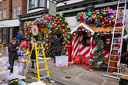 © Licensed to London News Pictures. 30/11/2020. London, UK. Christmas decorations go up at the the Ivy restaurant in Chelsea, London this afternoon. The Government has announced a new Covid 3 tiered system will come into effect in England on Wednesday 2nd December 2020 marking the end of lockdown with all non-essential shops, swimming pools, gyms and golf courses allowed to reopen again for the Christmas period. Photo credit: Alex Lentati/LNP