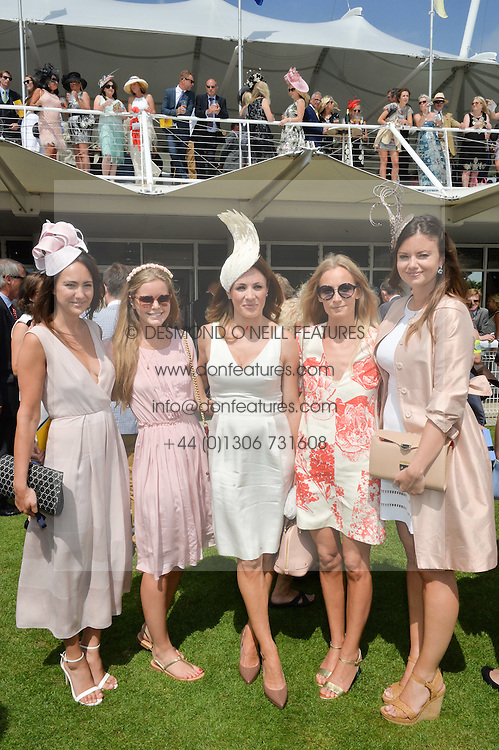 Left to right, LAVINIA BRENNAN, KATIE READMAN, NATALIE PINKHAM, MARTHA WARD and LADY NATASHA RUFUS-ISAACS at the 2014 Glorious Goodwood Racing Festival at Goodwood racecourse, West Sussex on 31st July 2014.