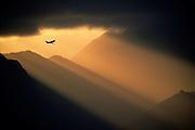 Image of a plane flying over Maui, Hawaii, Hawaiian Islands by Randy Wells