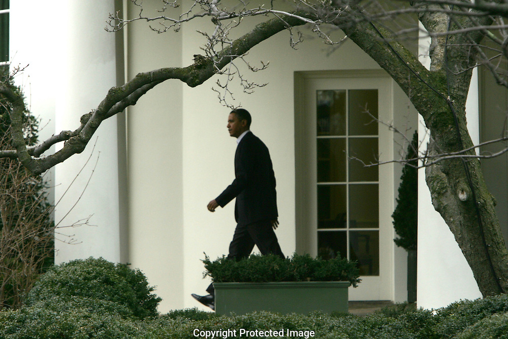 President Barack Obama walks from the Oval Office to Marine One as he departs for a trip to Lorain County,Ohio.  Photo by Dennis Brack