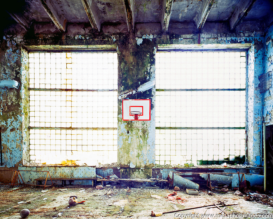 Gymnasium, 2003, Ukraine.<br /> The city of Pripyat lies abandoned next to the Chernobyl nuclear power station. In April 26, 1986, the worst nuclear accident the world has seen contaminated large areas of Europe with radioactive fallout. Vast areas of land around the reactor make up the Chernobyl Exclusion Zone. The area is now an increasingly popular tourist destination. <br /> <br /> Wastelands is a journey into abandoned and transient spaces in Australia and Europe. Over a number of years I've travelled with a large format camera to record some of the unusual ways that buildings decline, and the more unusual ways that space is reordered. <br /> <br /> A common practice is to transform abandoned industrial sites into modern centres of consumption. Old industrial centres often find new life as shopping centres. But family fun parks in abandoned nuclear power stations and the prospect of a European wilderness in Chernobyl reveal that landscape is never a finished project, nor what we always expect.<br /> <br /> <br /> Large format photography has had a long association with architecture and landscape. It expands detail and corrects perspective, often recording more than we can actually see, compelling us to look longer.