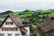 View of green pastures from top floor window of Appenzell Museum, which is in the town hall. Appenzell village is in Appenzell Innerrhoden, Switzerland's most traditional and smallest-population canton (second smallest by area). Switzerland, Europe.