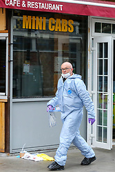 © Licensed to London News Pictures. 22/09/2019. London, UK. A forensics officer walks past the blood stained clothing  on Langham Road in North London near Turnpike Lane underground and bus station where three men were stabbed and rushed to hospital. Met police were call shortly after 4pm this afternoon to Langham Road and found three men suffering from stab wounds. According to the Met Police, two men have been arrested on suspicion of GBH. Photo credit: Dinendra Haria/LNP