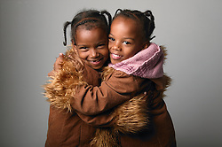 Portrait of two sisters hugging,