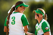 Oregon infielder Nikki Udria (3) and Oregon infielder Jenna Lilley (00) share a laugh during the first inning. The Oregon Ducks play the ASU Sun Devils at Howe Field in Eugene, Oregon on April 11, 2015. (Ryan Kang/Emerald)