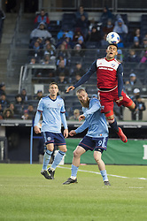 April 29, 2018 - Bronx, New York, United States - FC Dallas forward CRISTIAN COLMAN (9) heads the ball over New York City forward JO INGE BERGET (9) during a regular season match at Yankee Stadium in Bronx, NY.  NYCFC defeats FC Dallas 3 to 1. (Credit Image: © Mark Smith via ZUMA Wire)