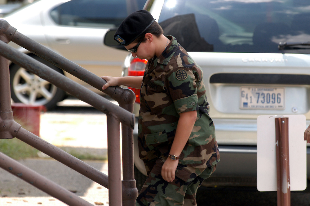 FORT BRAGG, NC- AUGUST 6: Pfc. Lynndie England returns from a lunch recess at the Staff Judge Advocate Building on Fort Bragg in Fayetteville, NC on 8/6/04 for her Article 32 investigation hearing. England is charged with several counts, including one specification of conspiring to commit maltreatment of an Iraqi detainee, three specifications of assault against Iraqis, and several others. (Photo by Logan Mock-Bunting)