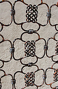 Intricate patterns on the wrought iron gates of the Centro Académico y Cultural San Pablo in Oaxaca, Mexico.