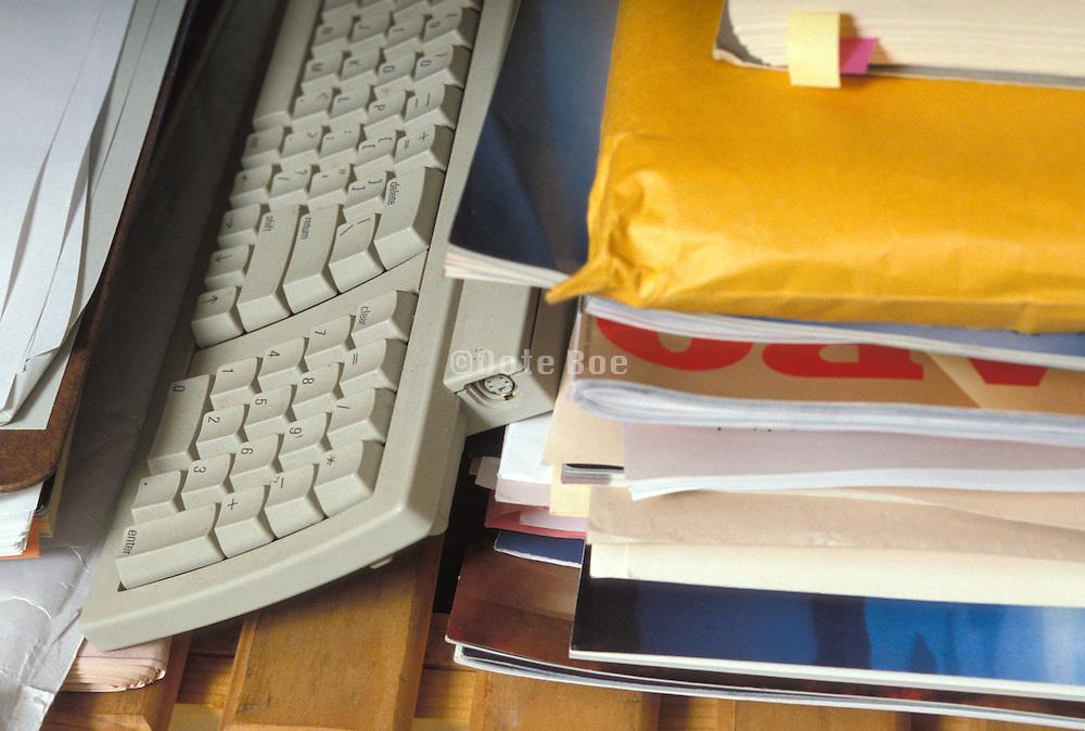 keyboard stored between paperwork