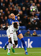 M'bate Niang of Watford battles with Yohan Benalouane of Leicester city ®. Premier league match, Leicester City v Watford at the King Power Stadium in Leicester, Leicestershire on Saturday 6th May 2017.<br /> pic by Bradley Collyer, Andrew Orchard sports photography.