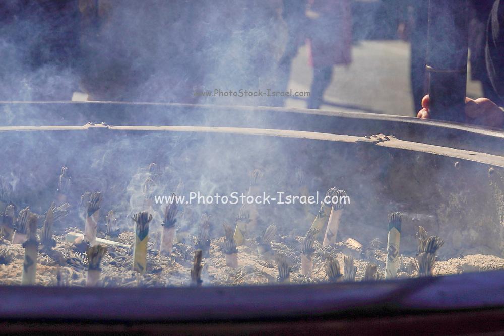 Japan, Tokyo, Asakusa, Senso-ji temple burning incense sticks