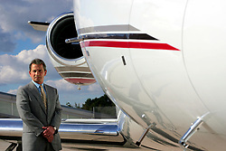 UK ENGLAND FARNBOROUGH 26SEP06 - Chairman of NetJets, Richard Santulli poses for a portrait in front of his Cessna 560XLS Citation Excel jet parked on the tarmac of TAG Farnborough airport in Hampshire, England...jre/Photo by Jiri Rezac..© Jiri Rezac 2006..Contact: +44 (0) 7050 110 417.Mobile:  +44 (0) 7801 337 683.Office:  +44 (0) 20 8968 9635..Email:   jiri@jirirezac.com.Web:    www.jirirezac.com..© All images Jiri Rezac 2006 - All rights reserved.
