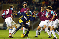 Photograph: Scott Heavey.<br />Wimbledon v West Ham United. Nationwide Division One. 15/11/2003.<br />Patrick Agyemang is crowded out by the West Ham defence